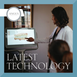 Dr. Poonum Bharal points at a computer screen with a digital image of the tooth structure showcasing the itero scanner technology to a woman looking on. Text: Angus Dentistry logo and Latest Technology